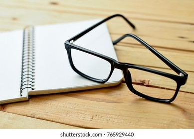 Table of writer with glasses and notebook