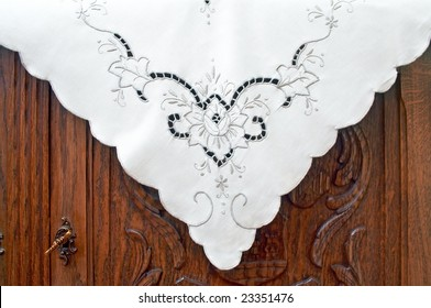 Tablecloth on the old dresser