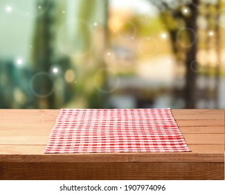 Tablecloth on wooden table and room background.