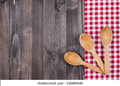 Tablecloth, spoons on wood table background