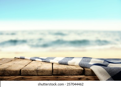 tablecloth and table of wood and sea