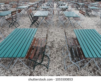 Tables and chairs of a beer garden in winter: Longing for summer
