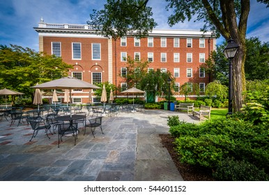 Tables and chairs, and a building at Harvard Business School, in Boston, Massachusetts.