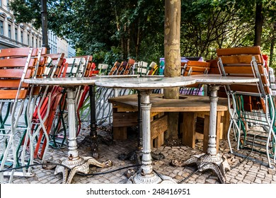 tables and chairs of a closed cafe bar restaurant