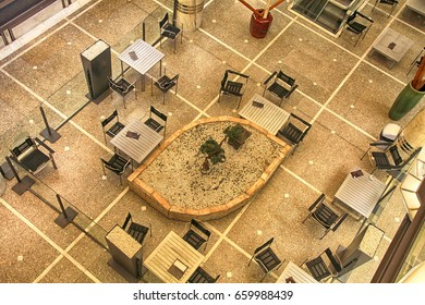 Tables and chairs in contemporary cafe, view from above, Switzerland