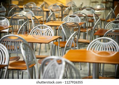 tables and chairs in food court interior abstract background