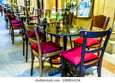 tables and chairs at an old cafe
