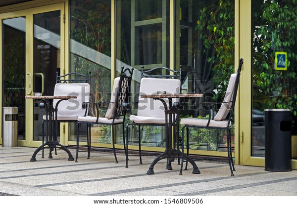 tables-chairs-on-summer-terrace-600w-154