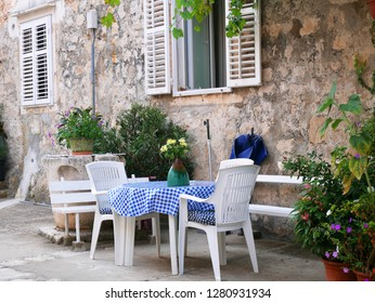 Tables and chairs of outdoor cafe in Croatia, Dubrovnik. Beautiful empty cafe with served tables