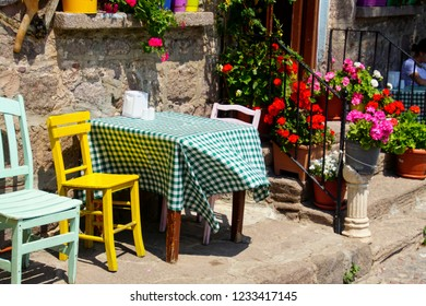 Tables and chairs of an outdoor restaurant in Behramkale Assos, Turkey