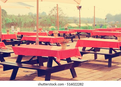 tables and chairs at an outdoor restaurant in farm