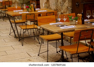 Tables and chairs of an outdoor restaurant in Split, Croatia