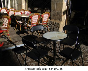 Tables and chairs  for outdoors dining in Turenne, France