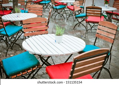 Tables and chairs outside in the rain
