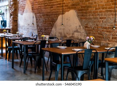 Tables and chairs over wall of old building,restaurant