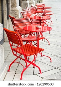 tables and chairs at a sidewalk cafe in rome - italy