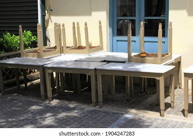 Tables and chairs stacked outside closed cafe-restaurant due the Coronavirus lockdown - Athens, Greece, May 6 2020.