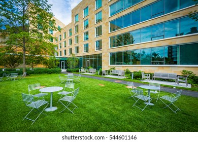 Tables and chairs, and Tata Hall, at Harvard Business School, in Boston, Massachusetts.