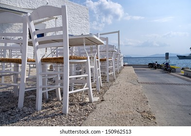 Tables and chairs of a tavern in Spetses island, Greece