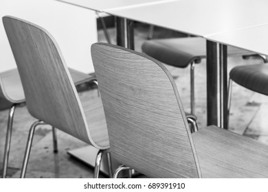 Tables and chairs wait for visitors in the food court in shopping center