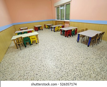 tables and chairs in the wide dining hall of a school for children
