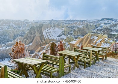 The tables of outdoor cafe, located on the cliff, overlooking the Pigeon Valley, Cappadocia, Turkey.