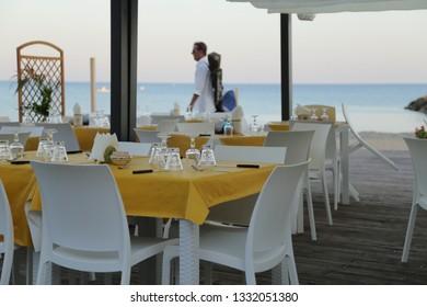 Tables set for dinner in an open-air restaurant