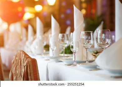 Tables set and salad served for a wedding reception.