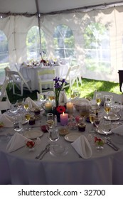 Tables set up in a tent at a wedding