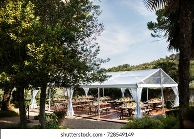 Tables sets for wedding or another catered event dinner. Courtyard of an Italian villa. Villa Bordoni