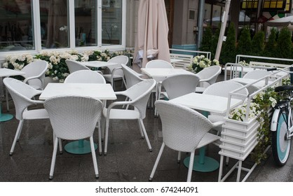 Tables of a street cafe after a rain