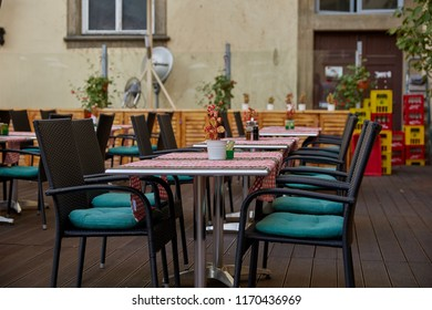 Tables with tablecloths and chairs on the terrace in a cafe in Prague, the Czech Republic.