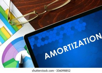 Tablet with amortization on a table. Business concept.
