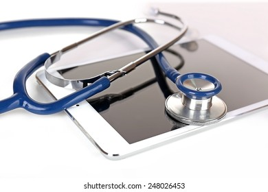 Tablet and blue stethoscope isolated on white
