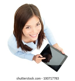 Tablet computer. Business woman using digital tablet computer PC happy isolated on white background. Beautiful mixed race Asian / Caucasian woman in business shirt with finger on touch screen display.