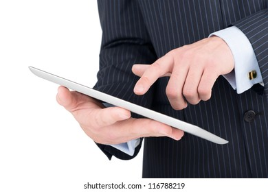 tablet computer in a businessman hands isolated on white