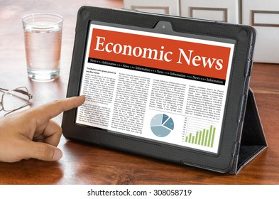A tablet computer on a desk - Economic News
