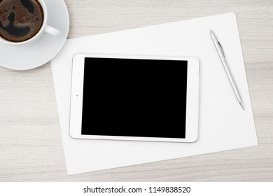 Tablet computer on the white table
