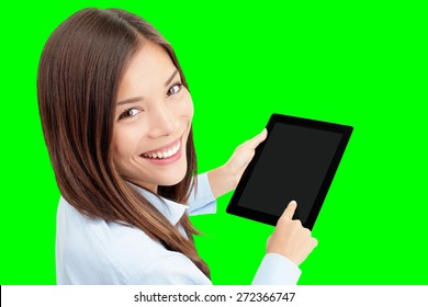Tablet computer. Woman using digital tablet computer PC isolated cutout on green chroma key background. Focus on both tablet and face. Woman in business shirt with finger on touch screen display.