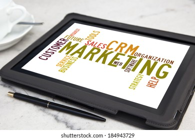 tablet with CRM marketing word cloud