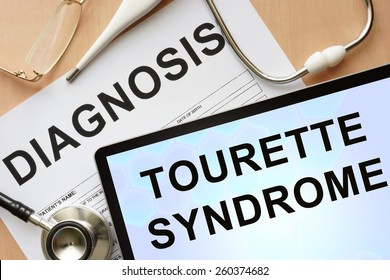 Tablet with diagnosis Tourette syndrome and stethoscope.
