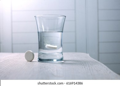 tablet dissolved in a glass of water