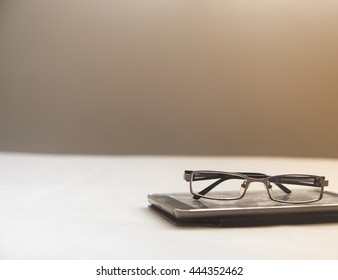 Tablet and glasses with sunlight effect