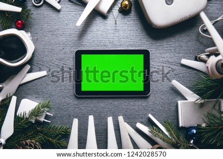 tablet with green screen drone equipment control panel on the background of a dark