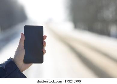 tablet in hand in winter