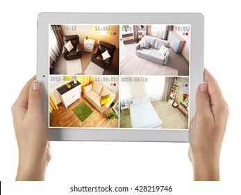 Tablet in hands isolated on white. Home security system concept