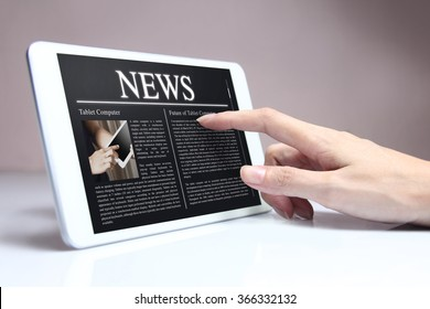 Tablet with hot news on screen. Tablet & smartphone reading of newspapers continues to grow rapidly in the future.