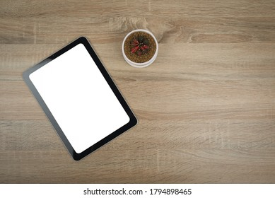 tablet isolated on wooden background