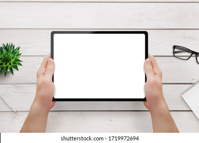 Tablet mockup in man hands. Isolated screen for app, web site promotion. Top view, flat lay