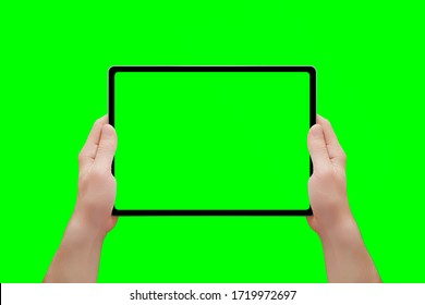 Tablet mockup in man hands isolated in chroma key green. Front position. Close-up